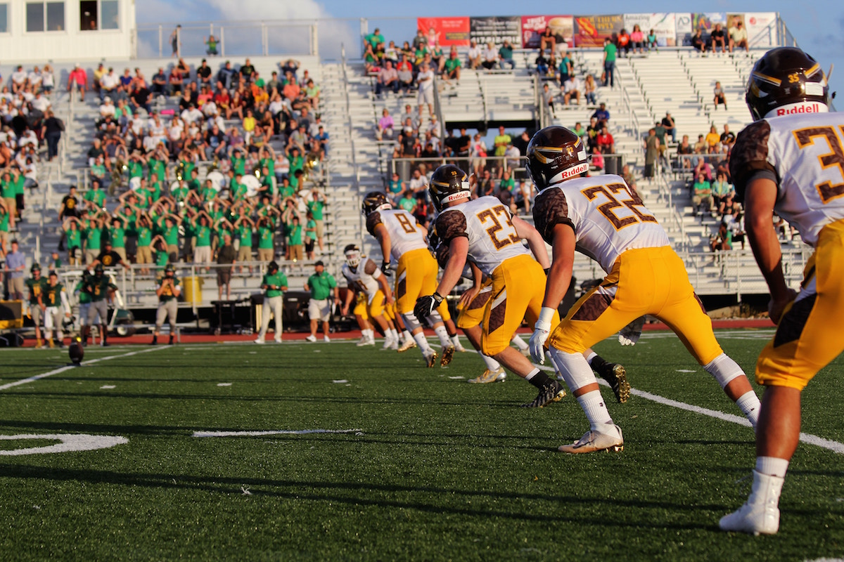 High school football players starting a game