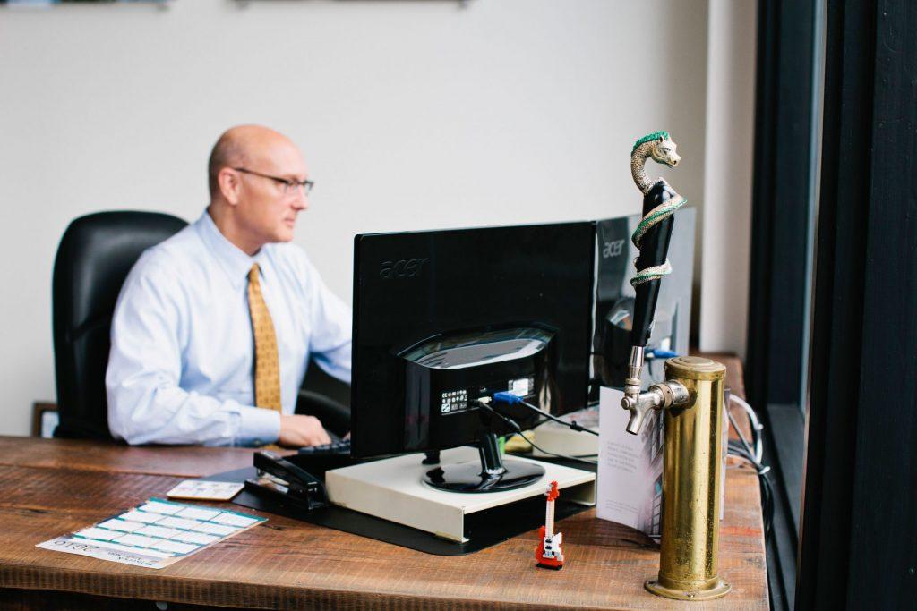 EPIC attorney John Christensen working at his desk