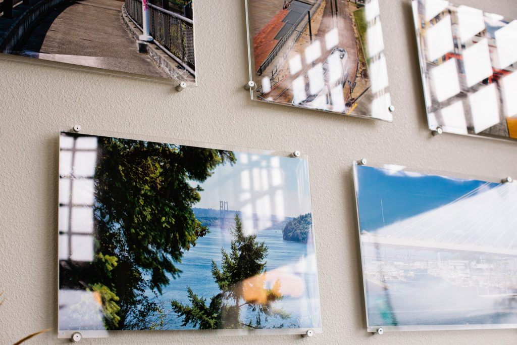 Scenic prints in acrylic frames in John Christensen's office