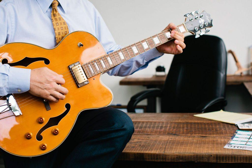 Close-up of John Christensen and his guitar
