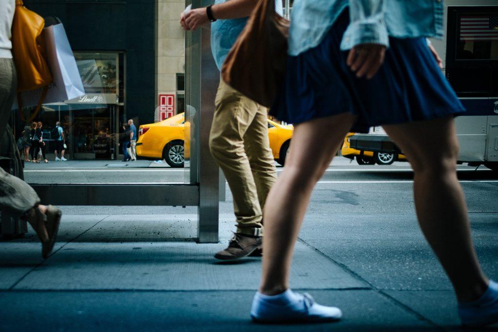 Pedestrians walking across busy street